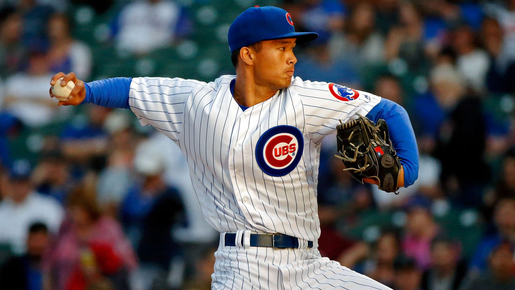 CHICAGO, IL - MAY 08:  Jen-Ho Tseng #52 of the Chicago Cubs pitches against the Miami Marlins during the first inning at Wrigley Field on May 8, 2018 in Chicago, Illinois.  (Photo by Jon Durr/Getty Images)