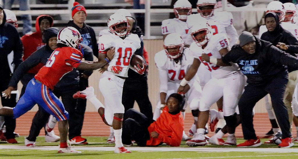 Skyline High School cornerback Milton Roundtree (10) is shoved out of bounds by J.J. Pearce High School running back Dequan Landon (45) after Roundtree made an interception to secure the victory late during the second half as J.J. Pearce High School hosted Skyline High School at Eagle/Mustang Stadium in Richardson on Friday night, November 8, 2019. (Stewart F. House/Special Contributor)