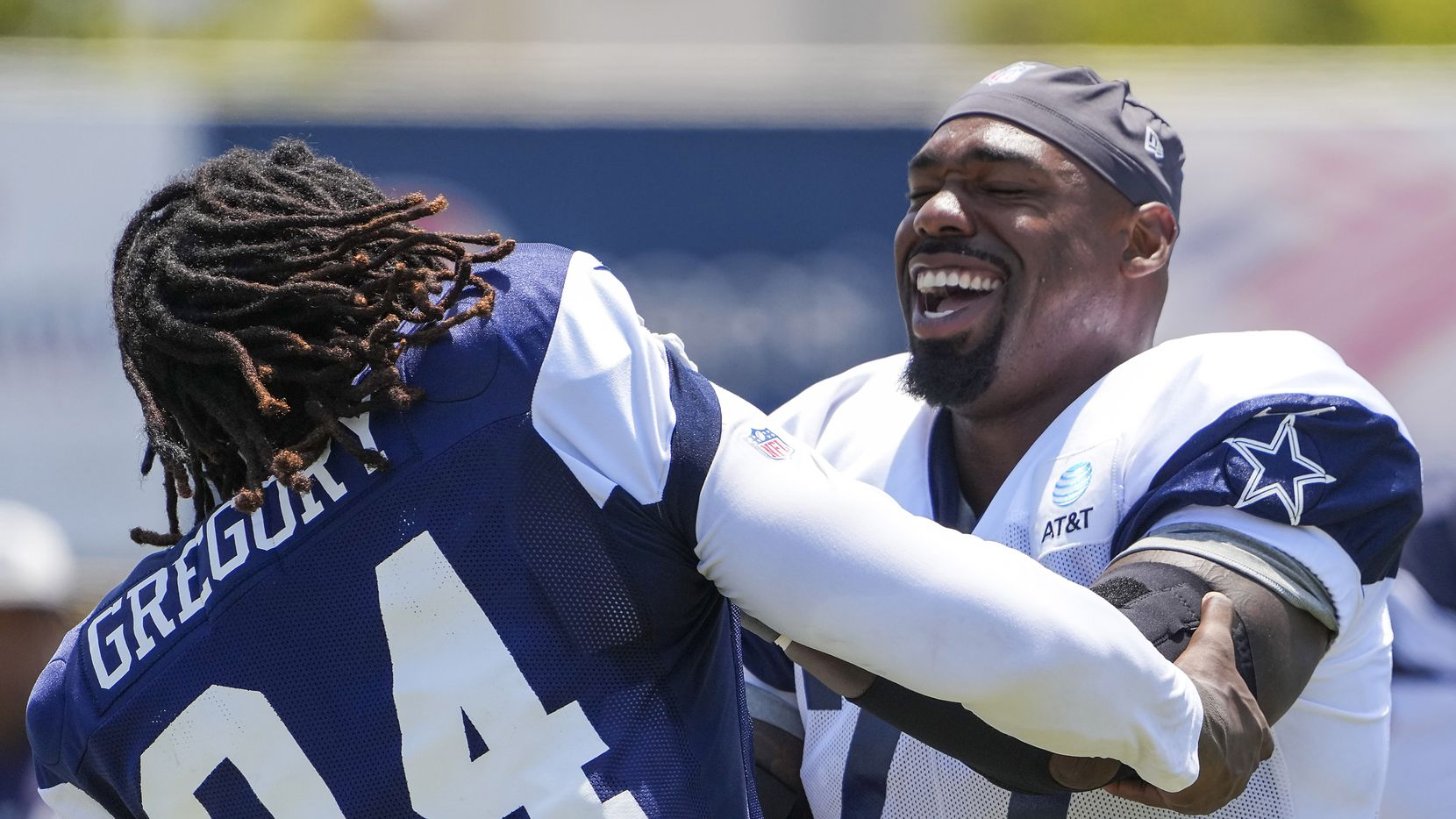 Dallas Cowboys defensive end Randy Gregory (94) works against tackle Tyron Smith (77) during a practice at training camp on Saturday, July 31, 2021, in Oxnard, Calif.