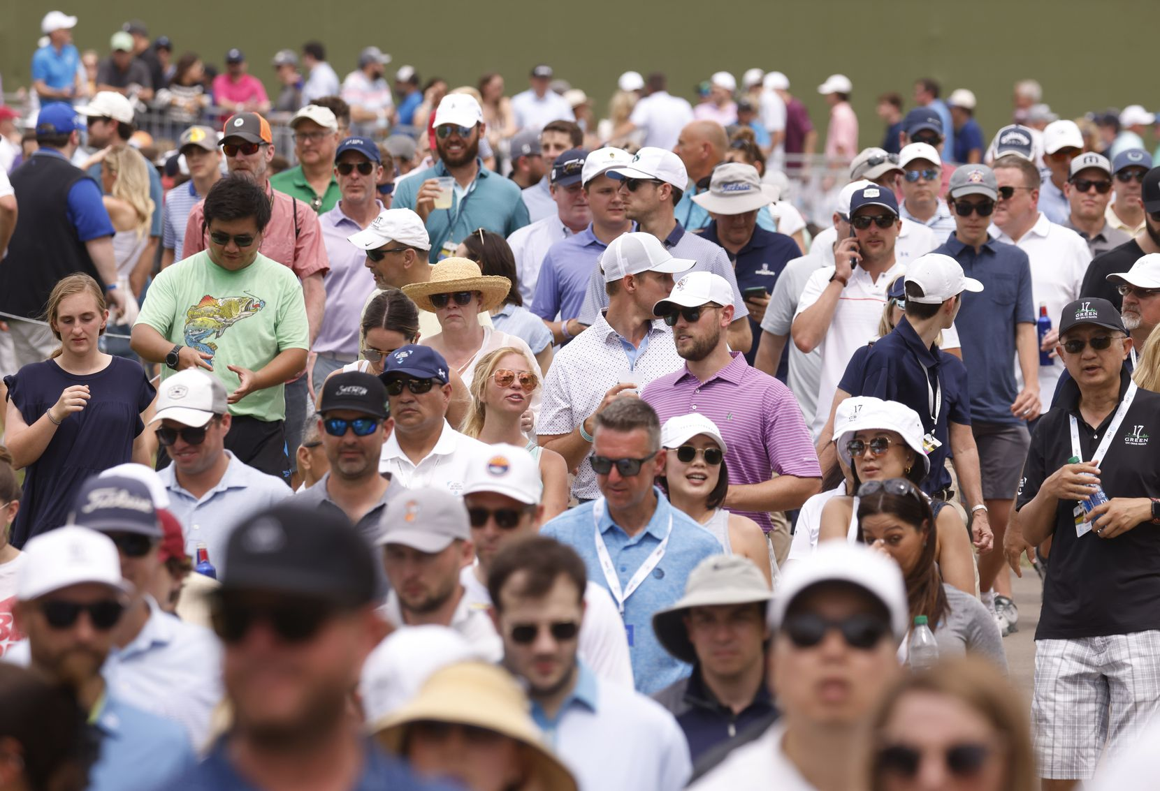 Fans make their way towards the green after watching Jordan Spieth tee off on the 13th hole during round 3 of the AT&T Byron Nelson  at TPC Craig Ranch on Saturday, May 15, 2021 in McKinney, Texas. (Vernon Bryant/The Dallas Morning News)