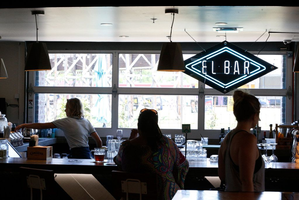 People sit at the bar at Americado in Fort Worth on April 9, 2017.