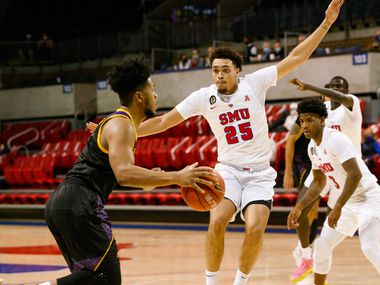 SMU forward Ethan Chargois (25) defends East Carolina forward Jayden Gardner (1) during the first half of a game at Moody Coliseum in Dallas on Wednesday, Dec. 16, 2020.