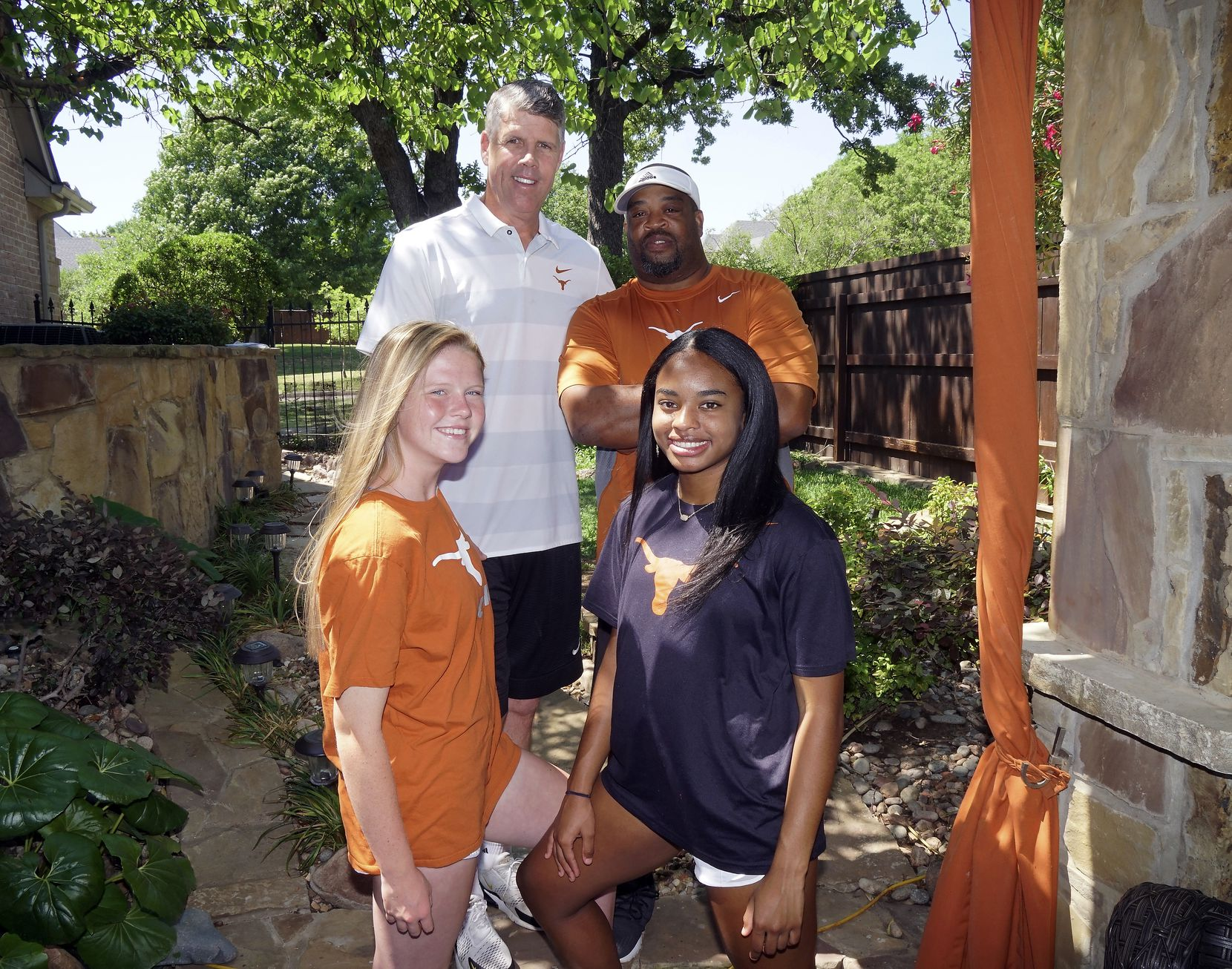 """(front, from left) Alexis """"Lexi"""" Missimo (17), and Trinity Byars (17) and (back from left) Derek Missimo and Charles Byars, at the Missimo home in Southlake, Texas on Monday, May 4, 2020."""