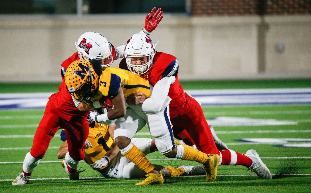 McKinney's Isaiah Wallace (3) and Isaiah Rojas (1) are brought down by McKinney Boyd's Caden Park (17) and Ethan Wesloski (31) during the second quarter of a high school football matchup between McKinney and McKinney Boyd at McKinney ISD Stadium on Friday, Nov. 8, 2019 in McKinney, Texas. (Ryan Michalesko/The Dallas Morning News)