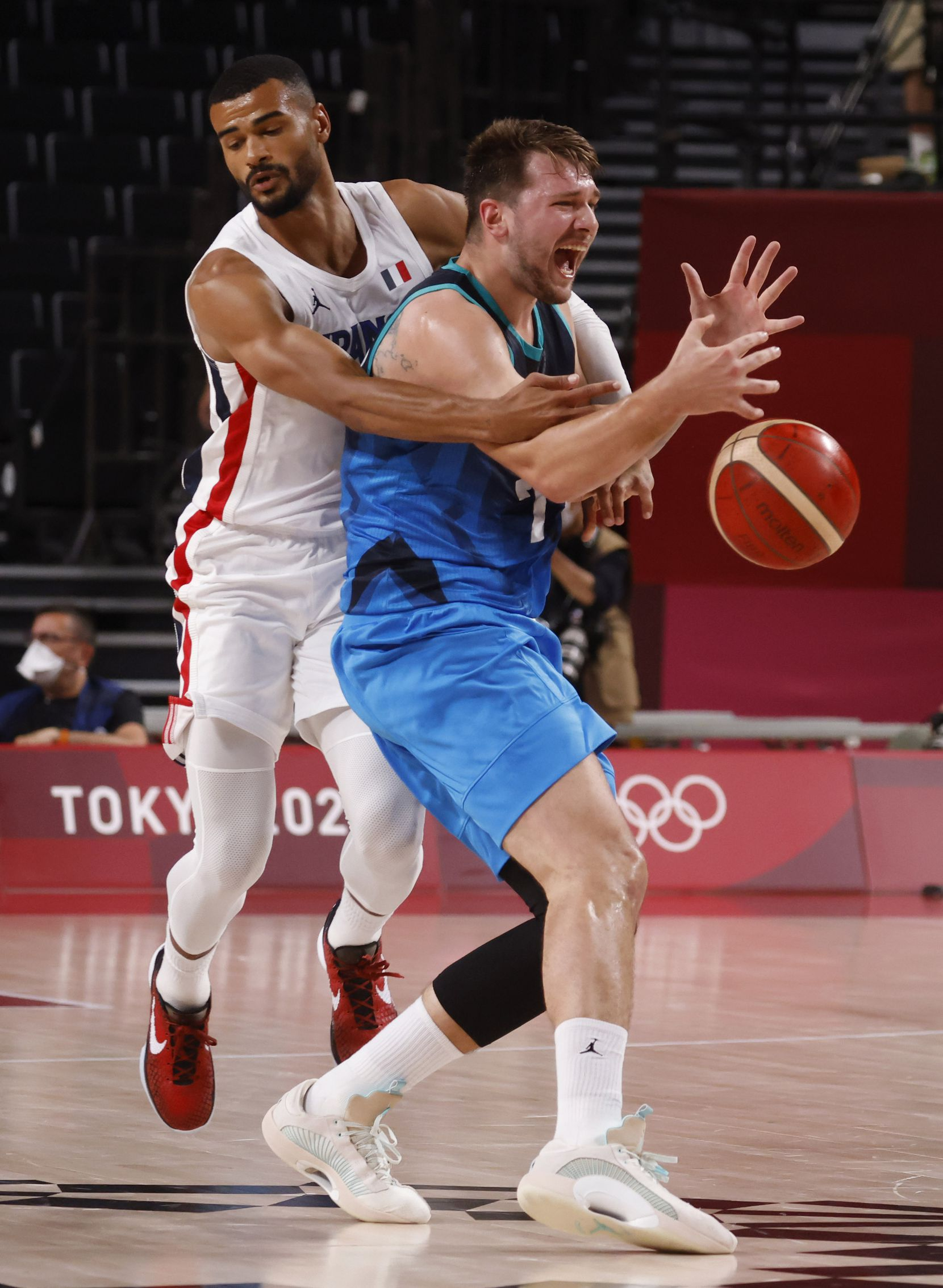 Slovenia's Luka Doncic (77) is fouled by France's Timothe Luwawu Cabarrot (3) during the first half of a men's basketball semifinal at the postponed 2020 Tokyo Olympics at Saitama Super Arena, on Thursday, August 5, 2021, in Saitama, Japan. (Vernon Bryant/The Dallas Morning News)