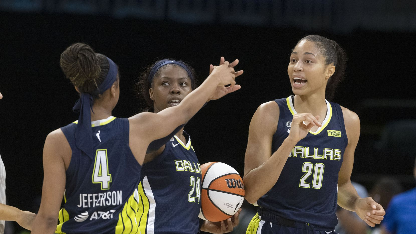 Dallas Wings guard Moriah Jefferson (4) guard Arike Ogunbowale (24) and forward Isabelle Harrison (20) celebrate as the defeated the Atlanta Dream during their WNBA basketball game in Arlington, Texas on Sept. 2, 2021. Dallas won 72-68.