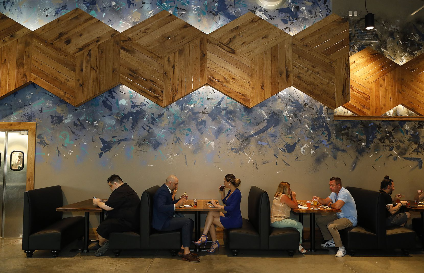 Artist Dan Black painted the art at Barley & Board. The six-sided pieces of wood, which change color throughout the restaurant, are supposed to artistically show the lifecycle of barley, the grain used to brew beer.