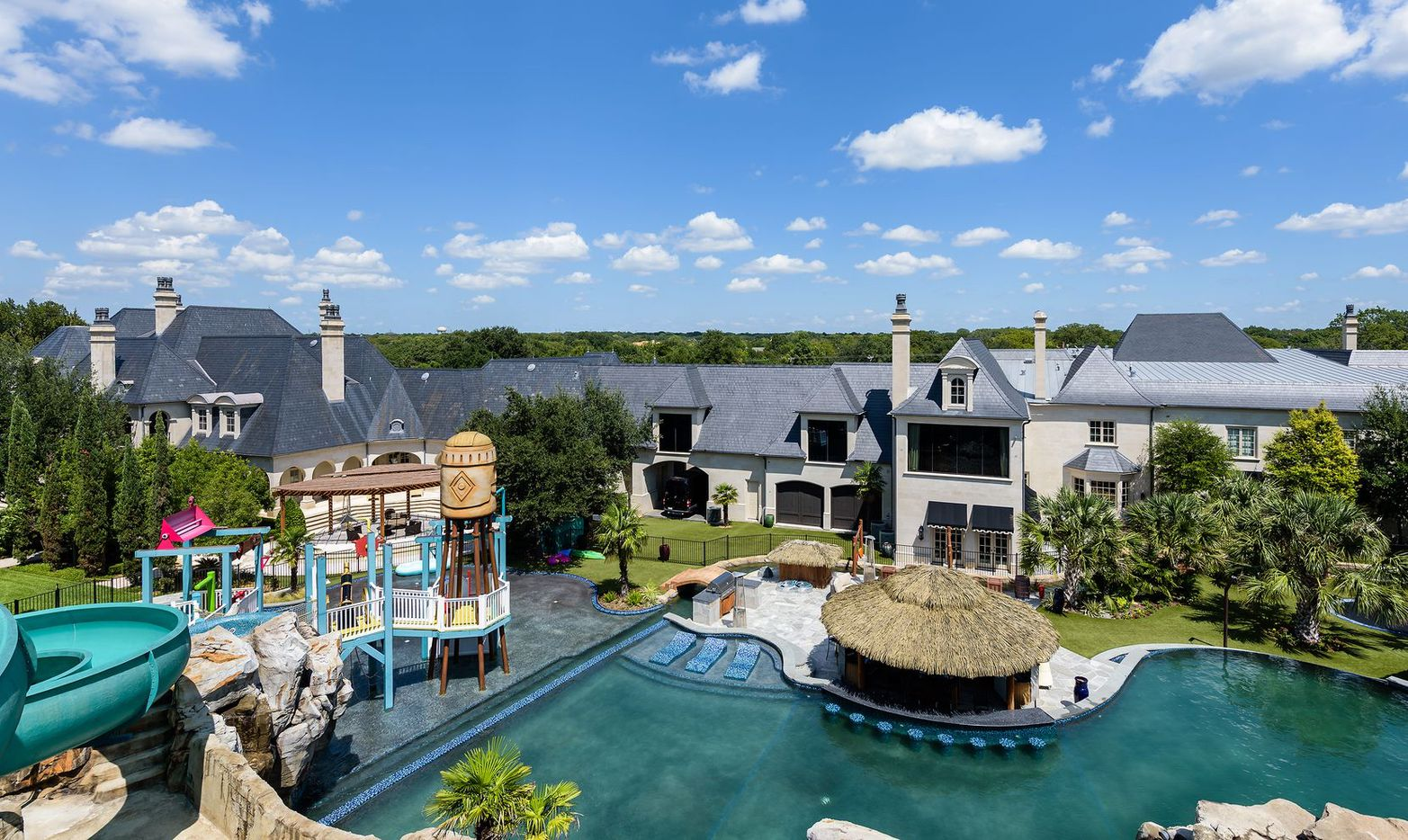 The more than four acre Preston Hollow estate has its own waterpark.