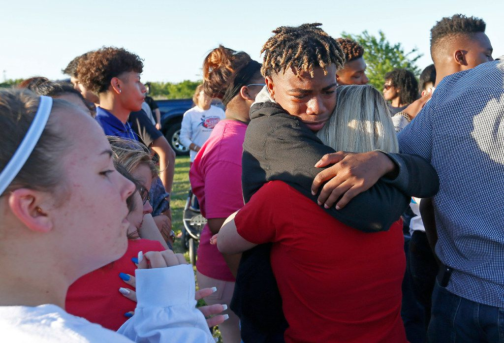 Denarius Roberts and Lani Proper console each other at a a vigil Monday for Jordan Edwards at Gentry Elementary School in Mesquite