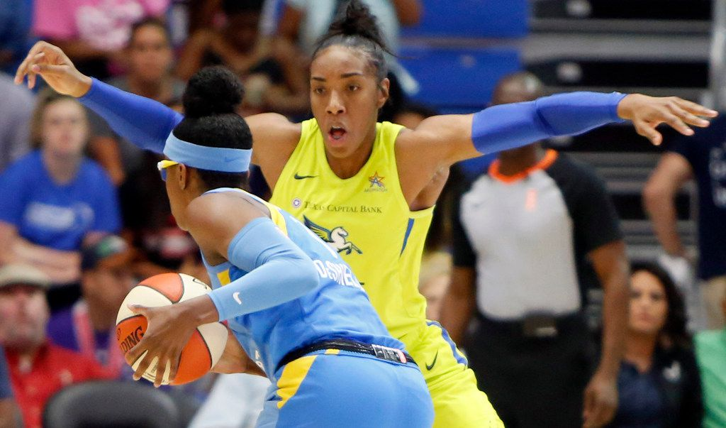 Dallas Wings forward Kayla Thornton (6) looms large defensively as she guards Chicago Sky guard Diamond DeShields (1) as she sets up an offensive play during first half action. The two teams played their WNBA game at College Park Center in Arlington on July 14, 2019.  (Steve Hamm/ Special Contributor)