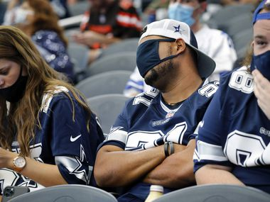 Dallas Cowboys fan Myles Morgan of Lindale, Texas (center) couldn't stand to watch his team fall further behind the Cleveland Browns during the third quarter at AT&T Stadium in Arlington, Texas, Sunday, October 4, 2020. He said it got the point where it was 'too sickening'. The Cowboys lost, 48-39. (Tom Fox/The Dallas Morning News)