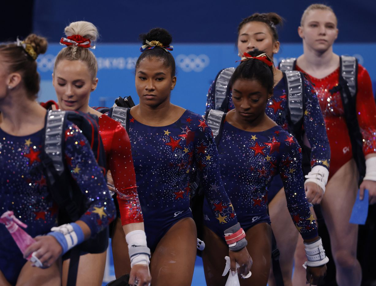 USA's MyKayla Skinner, Jordan Chiles, Simone Biles, Sunisa Lee, and Jade Carey of the women's gymnastics team makes their way to the uneven bars during a women's gymnastics event during the postponed 2020 Tokyo Olympics at Ariake Gymnastics Centre on Sunday, July 25, 2021, in Tokyo, Japan. (Vernon Bryant/The Dallas Morning News)
