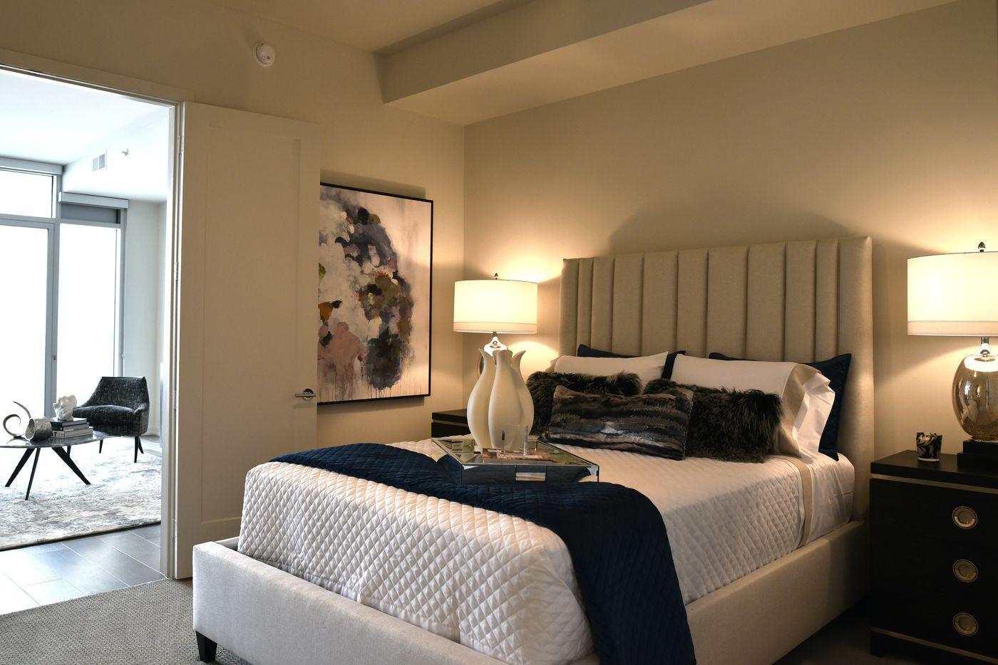 The bedroom of a model one bedroom apartment at the Twelve Cowboys Way luxury residential tower at the Star in Frisco.