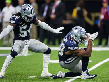 Dallas Cowboys defensive end Robert Quinn (58) and middle linebacker Jaylon Smith (54) celebrate after sacking New Orleans Saints quarterback Teddy Bridgewater (5) during the fourth quarter of an NFL game between the Dallas Cowboys and the News Orleans Saints on Sunday, September 29, 2019 at Mercedes-Benz Superdome in New Orleans, Louisiana. (Ashley Landis/The Dallas Morning News)