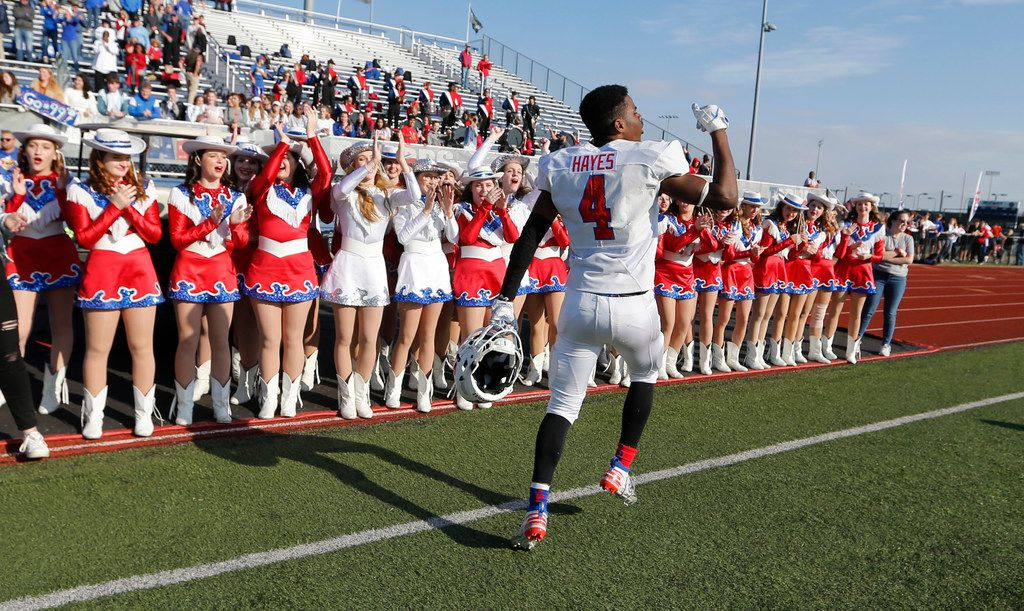 Parish Episcopal's Omari Hayes (4) celebrates on the sidelines after defeating Plano John Paul II 42-14 in the TAPPS Division I State Championship game at Waco Midway's Panther Stadium in Hewitt, Texas on Friday, December 6, 2019. (Vernon Bryant/The Dallas Morning News)