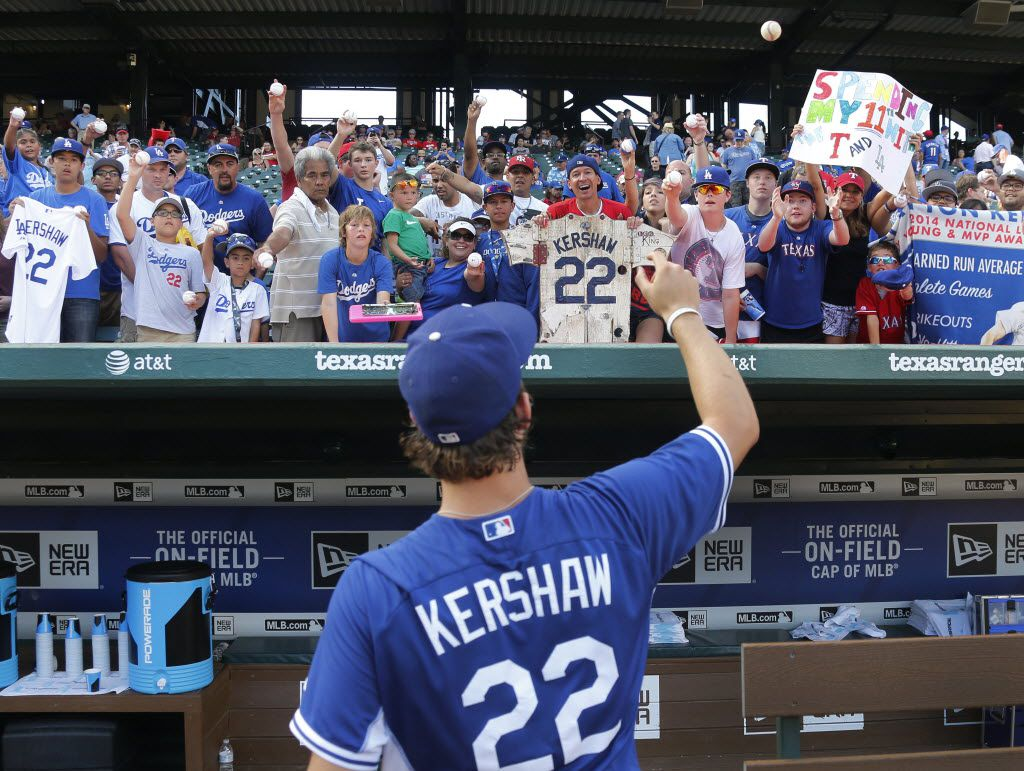 Los Angeles Dodgers pitcher Clayton Kershaw signs autographs before the Los Angeles Dodgers vs. the Texas Rangers major league baseball game at Globe Life Park in Arlington, Texas, on Monday, June 15, 2015. (Louis DeLuca/The Dallas Morning News) 06172015xSPORTS