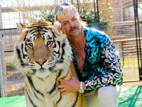"Joe Exotic with one of his many, many tigers in ""Tiger King."""