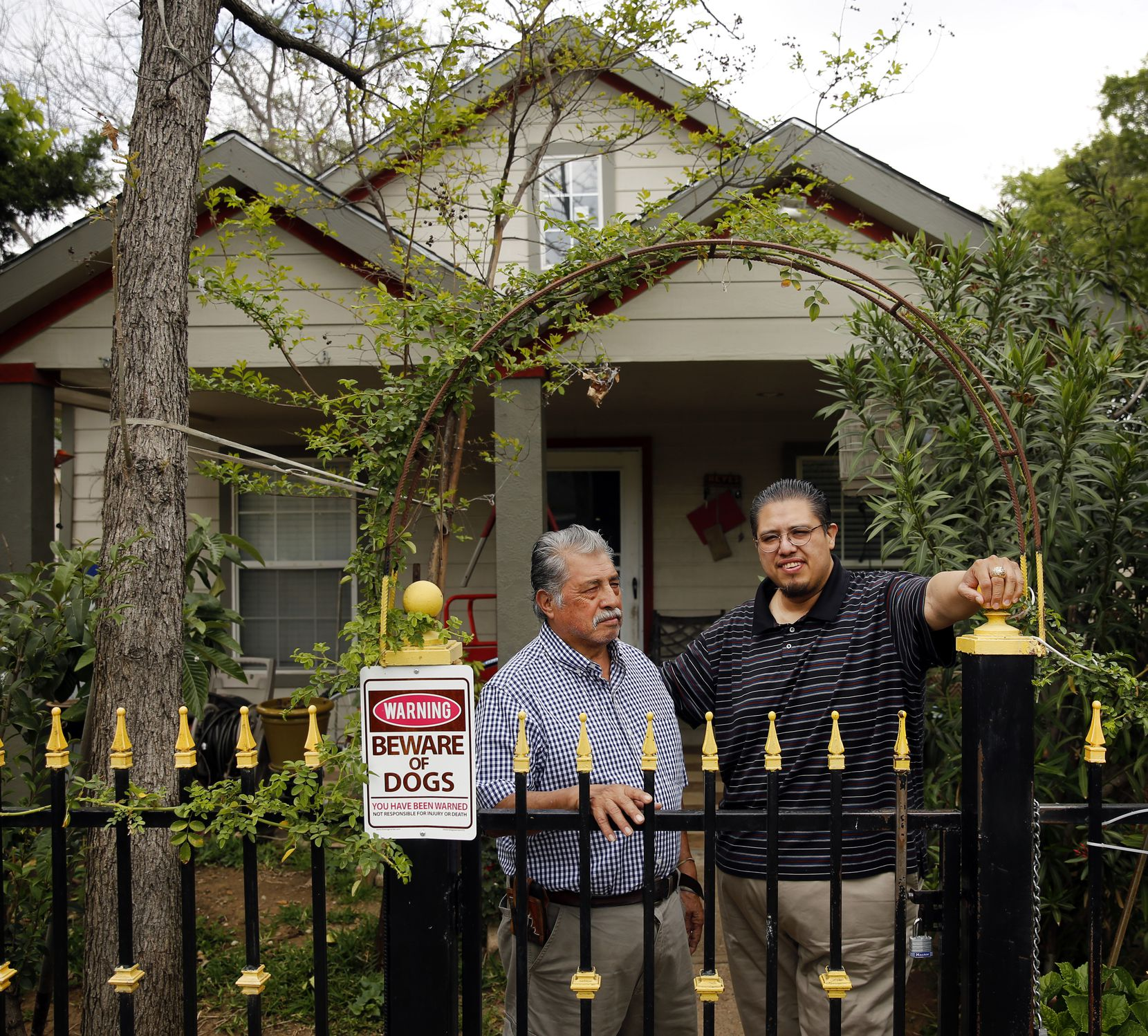 West Dallas homeowner Raul Reyes Sr (left) and his son Raul Reyes Jr pose for a photo in front of their family home off Sylvan Ave in Dallas, Wednesday, March 22, 2017. Reyes Jr. was born and raised across the street from his fathers current home (pictured). Reyes Sr has lived in the neighborhood since 1969. (Tom Fox/The Dallas Morning News)