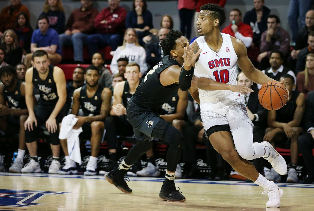 Southern Methodist Mustangs guard Jarrey Foster (10) attempts to get around UCF Knights guard Terrell Allen (2) in the first half of an NCAA basketball game between University of Central Florida and SMU at Moody Coliseum on the campus of Southern Methodist University in Dallas Wednesday December 27, 2017. Southern Methodist Mustangs led 26-21 at the half. (Andy Jacobsohn/The Dallas Morning News)