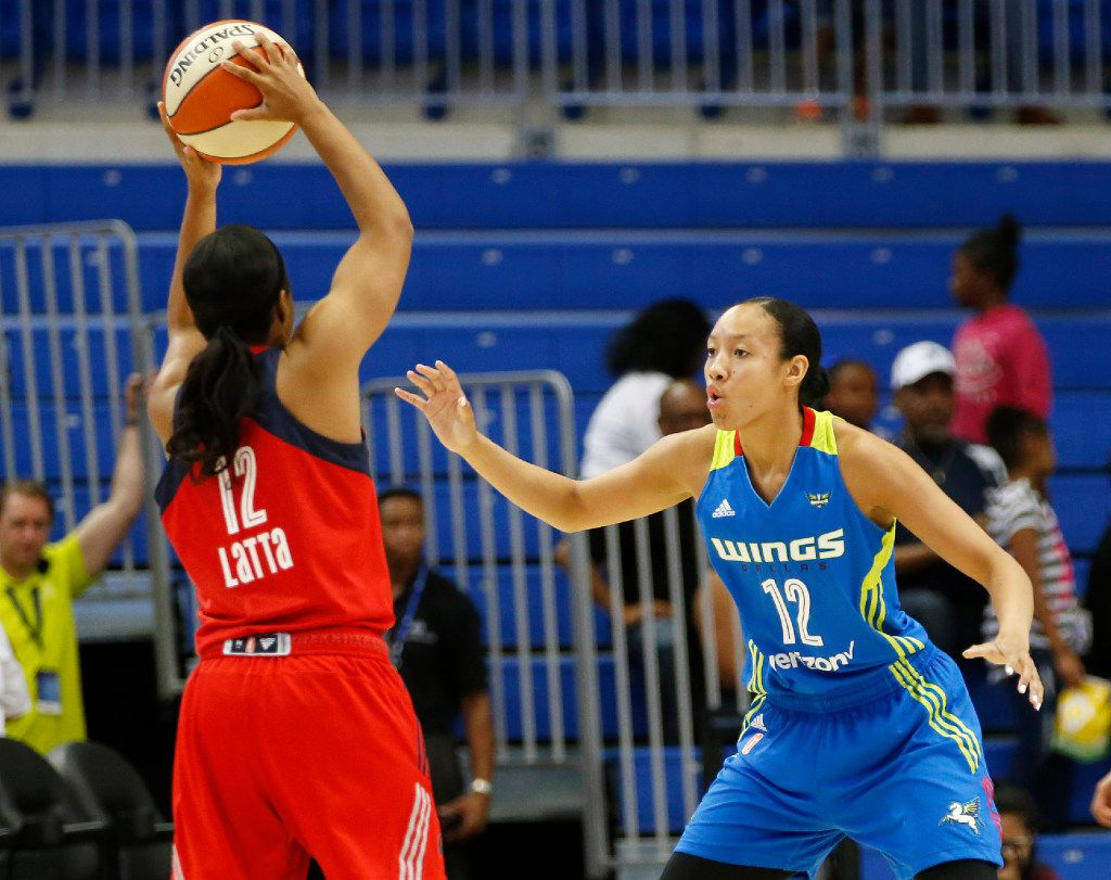 Dallas Wings Saniya Chong (12) defends as Washington Mystics Ivory Latta (12) looks to pass during the first half of play at UTA's College Park Center in Arlington on Tuesday, June 6, 2017. (Vernon Bryant/The Dallas Morning News)