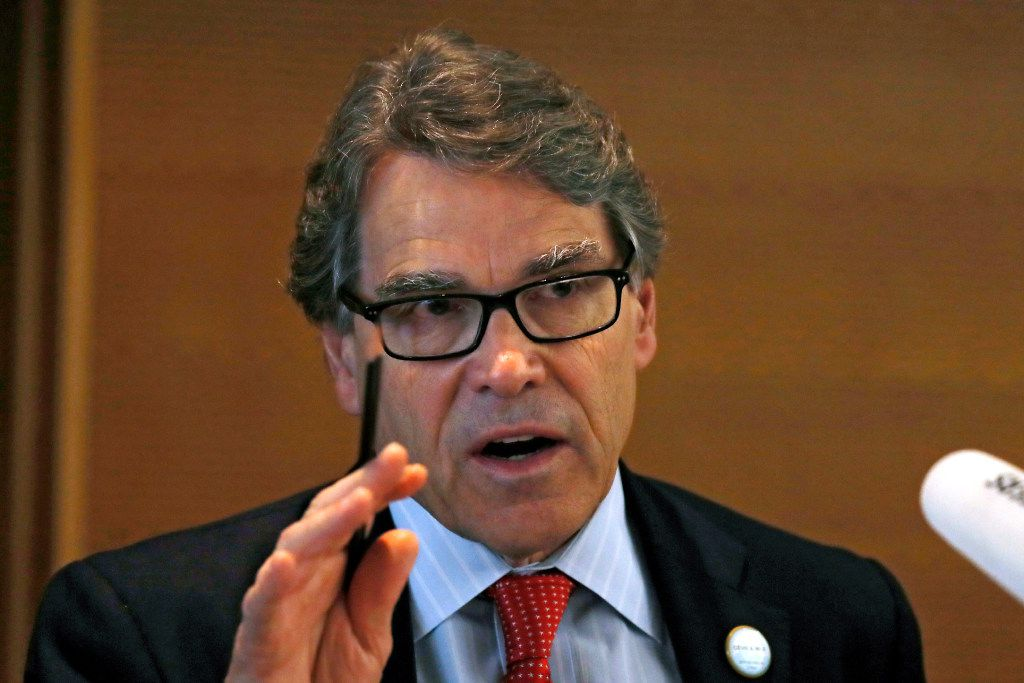 FILE - In this June 6, 2017, file photo, U.S. Energy Secretary Rick Perry speaks during the carbon capture, utilization and storage event, on the sidelines of the clean energy conference held at the China National Convention Center in Beijing. President Donald Trump and his cabinet often avoid talking about the science of climate change, but when pressed what they have said clashes with established mainstream science, data and peer-reviewed studies and reports.(AP Photo/Andy Wong, File)