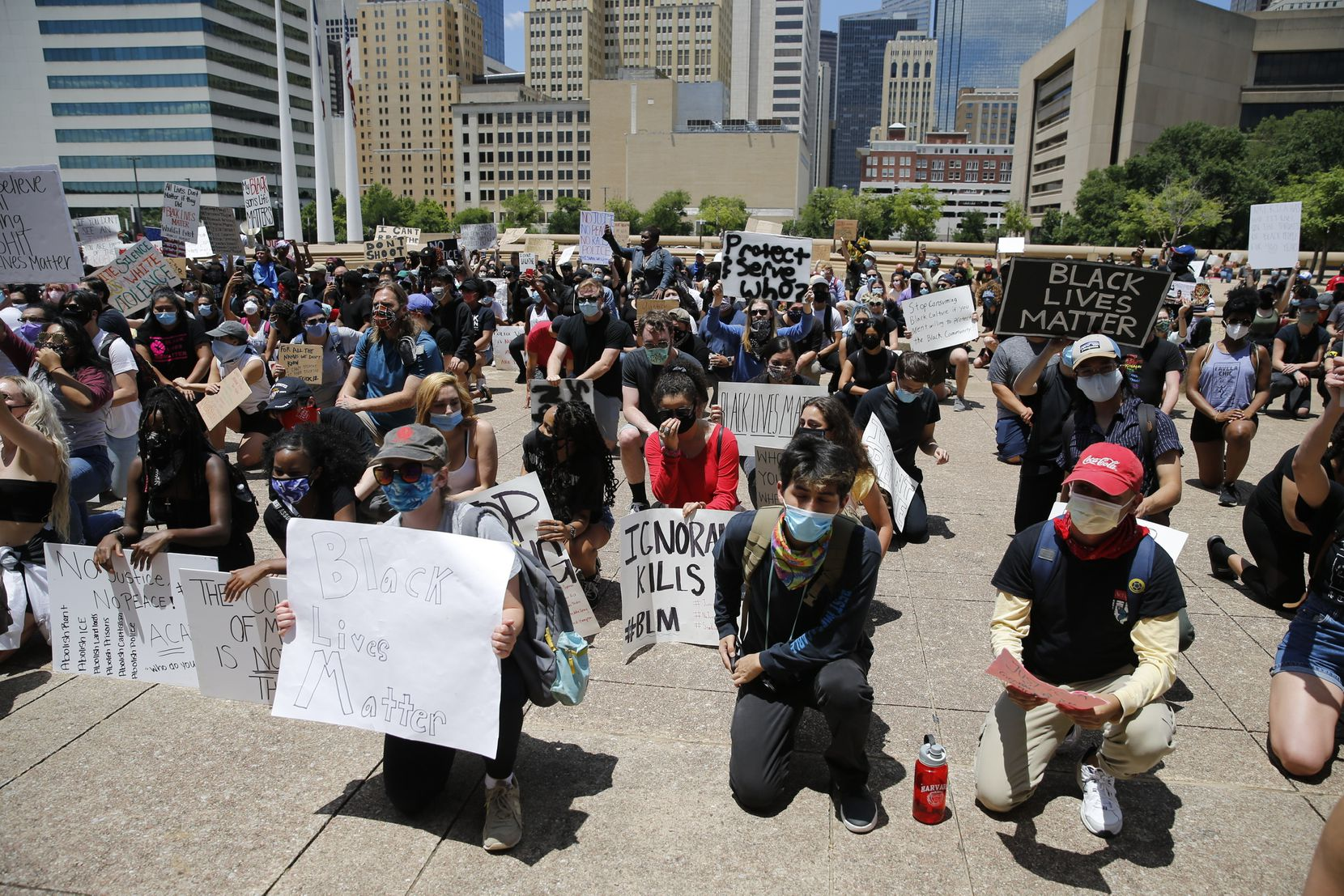 Protesters rally during a demonstration against police brutality in downtown Dallas, on Saturday, May 30, 2020. George Floyd died in police custody in Minneapolis on May 25.