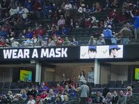 Signs encouraged fans to wear face masks as the Texas Rangers faced the Baltimore Orioles at Globe Life Field on April 17, 2021.