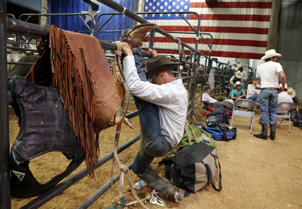 Bull rider McKennon Wimberly stretches at the Mesquite Rodeo on June 6, 2014. (Michael Ainsworth/The Dallas Morning News)