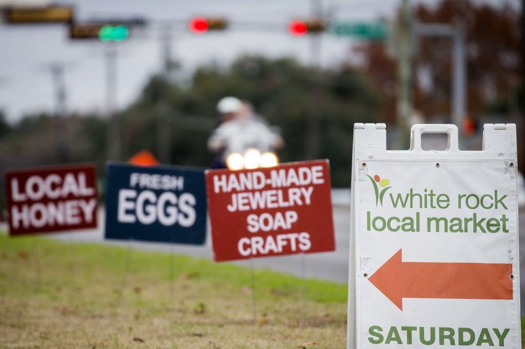 Signs point the way to the Good Local Markets Holiday Extravaganza at Lakeside Baptist Church