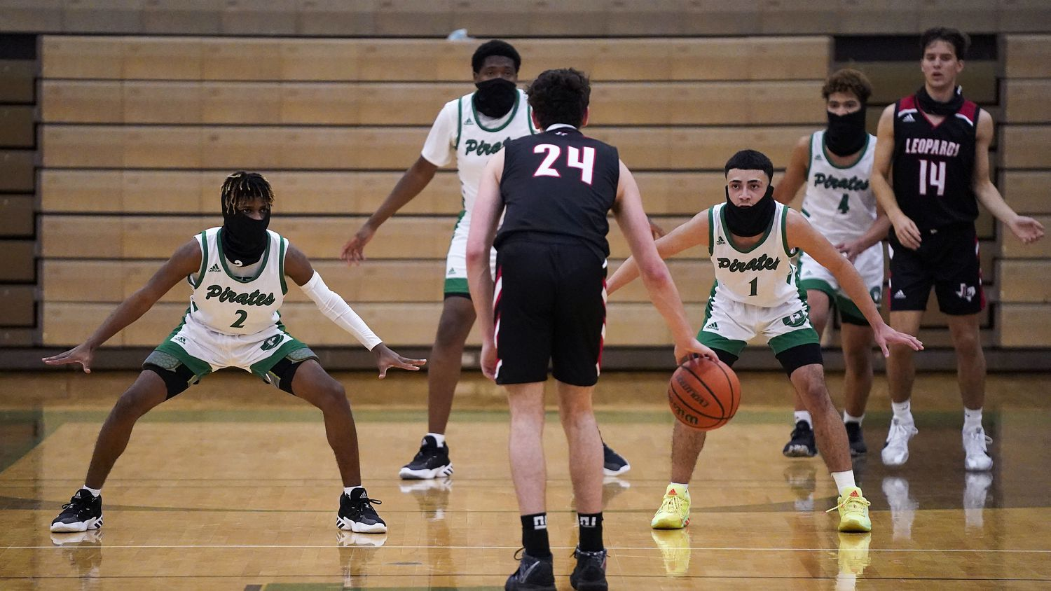 Mesquite Poteet guard Jeremiah Lynch (2), forward Tavarius Hamilton (back), guard Carlos Rodriguez (1) and guard Jeremiah Taylor (4) all wear face coverings as they set up on defense against Lovejoy guard Carson Holden (24) and forward Jeremy Van Riper (14) during a game on Tuesday, Nov. 17, 2020, in Mesquite.