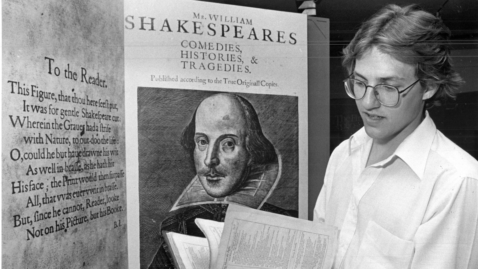 """Book binder and conservator Frank Mowery carefully examines one of 79 first editions of William Shakespeare's plays. Mowery is in the process of restoring the collection. Published in """"Book conservator gets Shakespeare volumes out of a bind"""" on Oct. 25, 1980."""