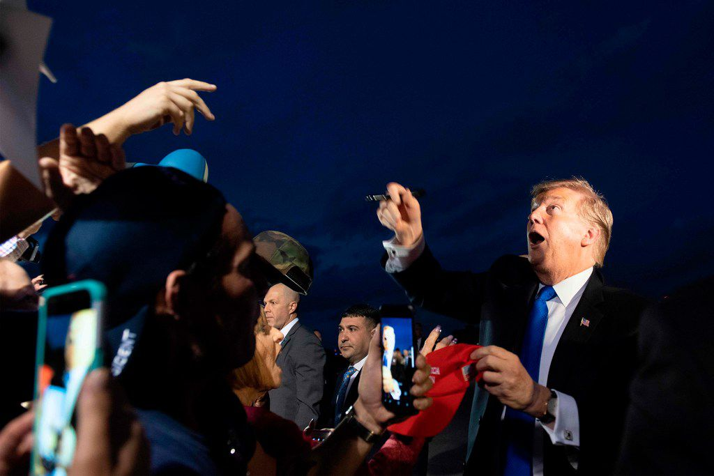 President Donald Trump is greeted by supporters upon his arrival in West Palm Beach, Florida, on February 15, 2019.