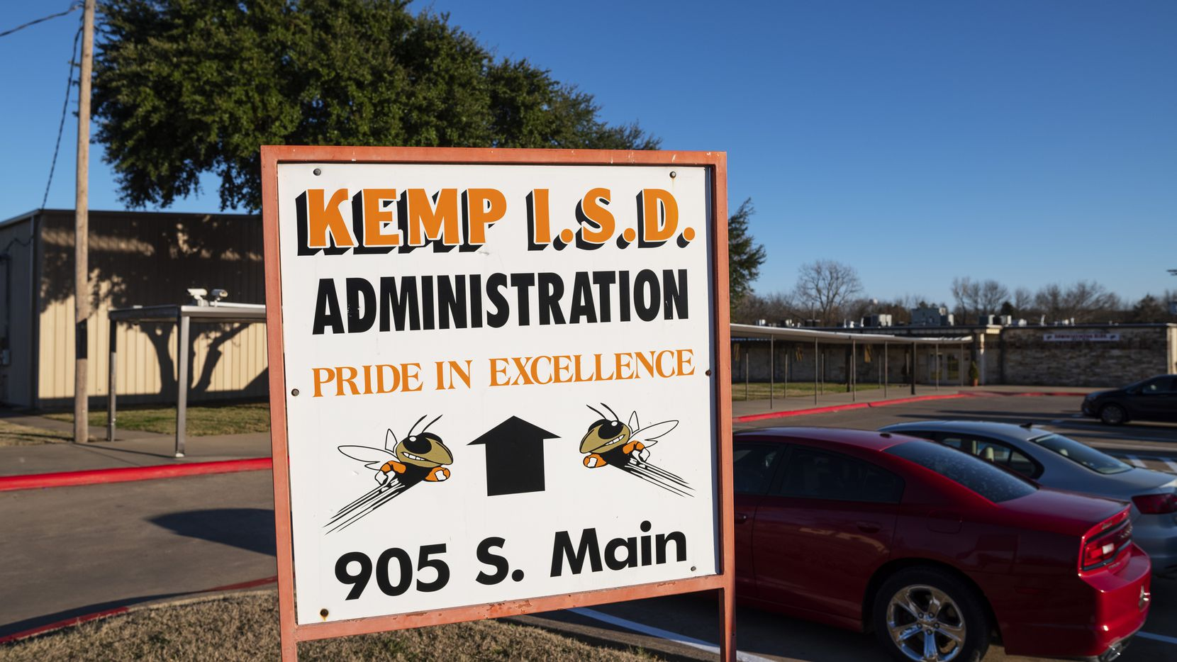 Signage outside of the Kemp ISD admin building before a board meeting, on Monday, Dec. 14, 2020. Kemp ISD will close its doors for the rest of the week due to rising COVID-19 cases.