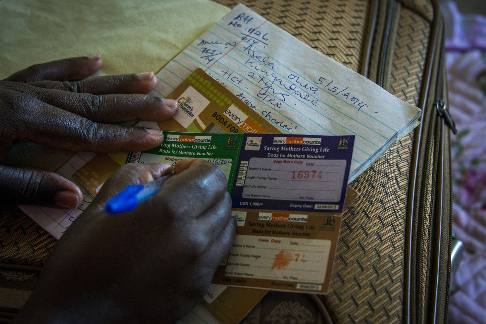 Boda boda drivers are paid with a voucher after delivering a mother to the nearest health facility. (Smiley N. Pool © 2014)