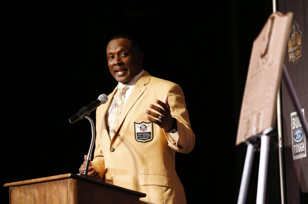 """FILE - Pro Football Hall of Famer Tim Brown during a presentation honoring him as a """"Hometown Hall of Famer"""" presented by the Pro Football Hall of Fame and Ford at Woodrow Wilson High School in Dallas on Friday, Nov. 6, 2015."""