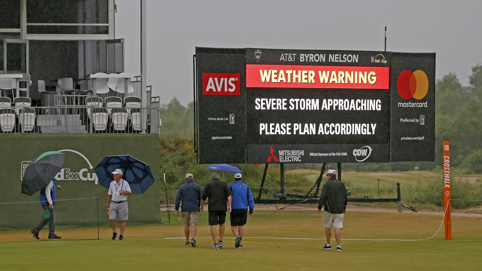 Fans crossed the 18th fairway during a weather delay of the final round of AT&T Byron Nelson at Trinity Forest Golf Club in 2018. (Jae S. Lee/The Dallas Morning News)