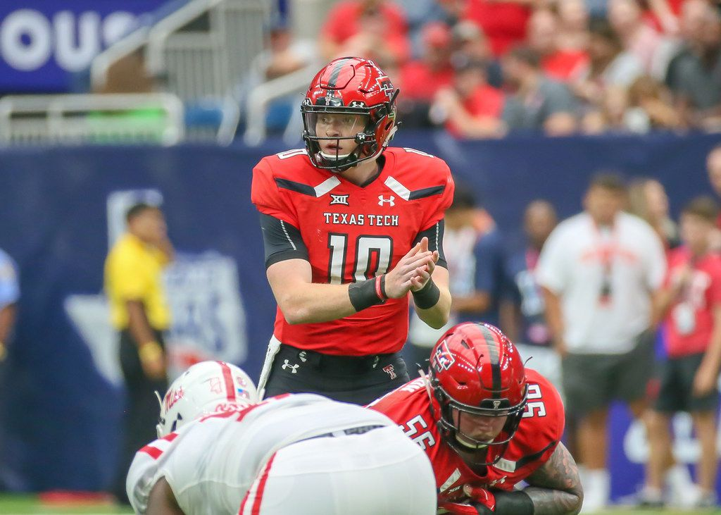 HOUSTON, TX - SEPTEMBER 01:  Texas Tech Red Raiders quarterback Alan Bowman (10) takes over the offensive line during the AdvoCare Kickoff college football game between the Texas Tech Red Raiders and Ole Miss Rebels on September 1, 2018 at NRG Stadium in Houston, Texas.