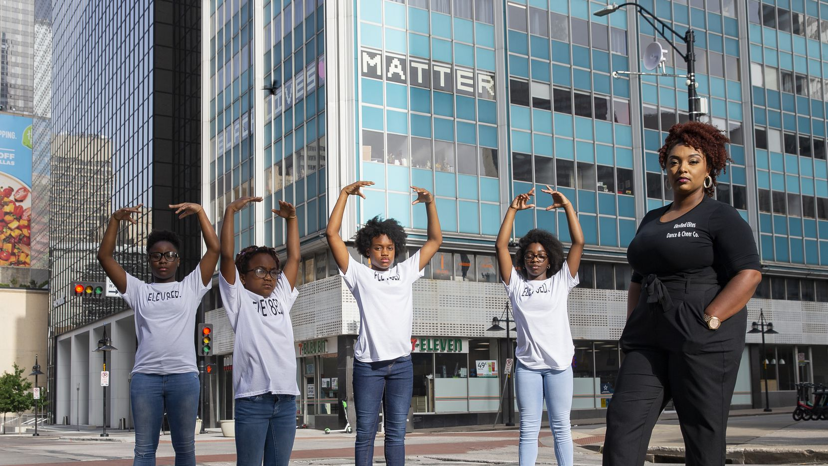 (From left) Members of Elev8ed Elites Dance, Janyiah Cooks, 12, Arianna Roberts, 7, Shakyra Roberts, 13, Zaria Fisher, 10, and dance director Shantrail White pose for a photo on June 27, 2020 in Downtown Dallas. Elev8ed Elites is an all girls dance team that shot a video downtown in response to police brutality shortly after George Floyd died. (Juan Figueroa/ The Dallas Morning News)