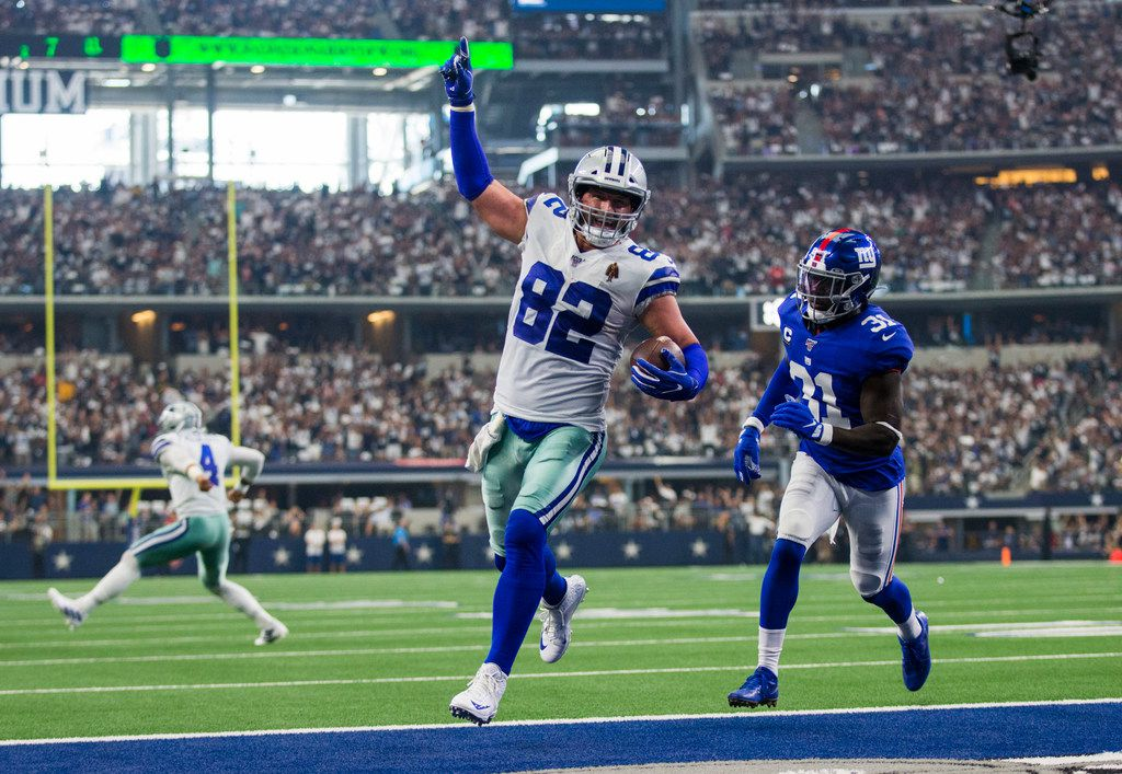 Dallas Cowboys tight end Jason Witten (82) celebrates as he runs to the end zone for a touchdown during the second quarter of an NFL game between the New York Giants and Dallas Cowboys on Sunday, September 8, 2019 at AT&T Stadium in Arlington. New York Giants defensive back Michael Thomas (31) is at right and Dallas Cowboys quarterback Dak Prescott (4) is at left.