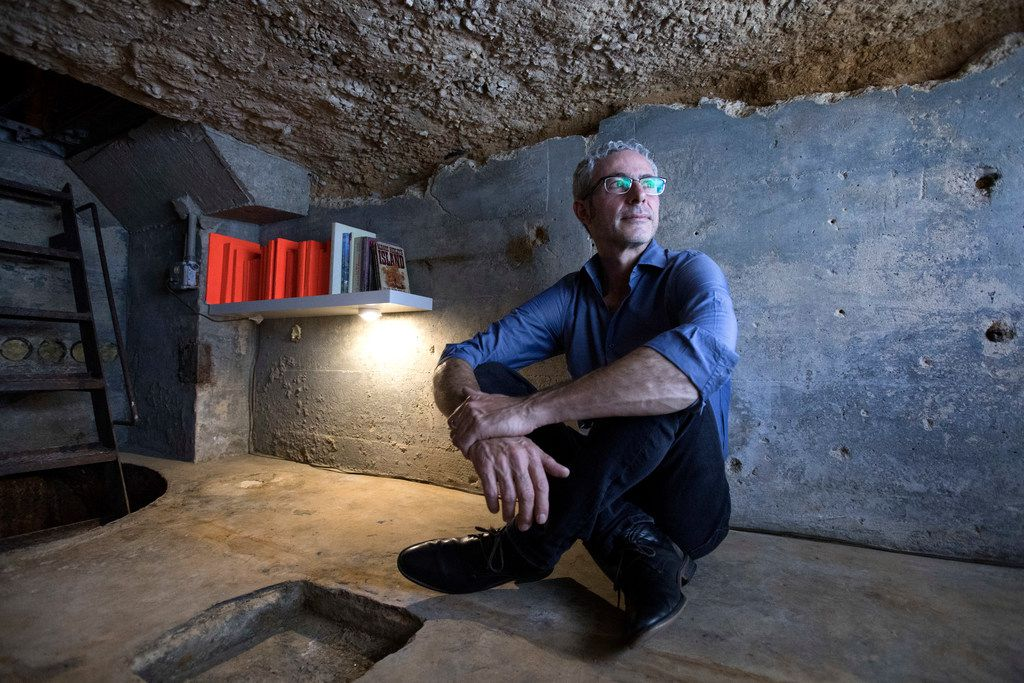 Mexico-based artist Carlos Ranc observes his artwork on display in Culture Hole
