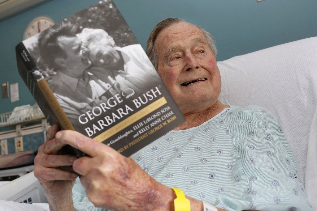 This file photo provided by Office of George H. W. Bush shows a photo of former President George H.W. Bush that was tweeted on June 1  from his hospital bed while reading a book about himself and his late wife in Biddeford, Maine.