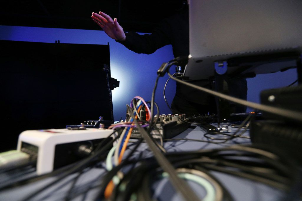 """David Stout, a composer and visual artist working with emerging technologies, controls a piece titled """"The Janus Switch"""" with an infrared sensor, percussion controller and other technologies."""