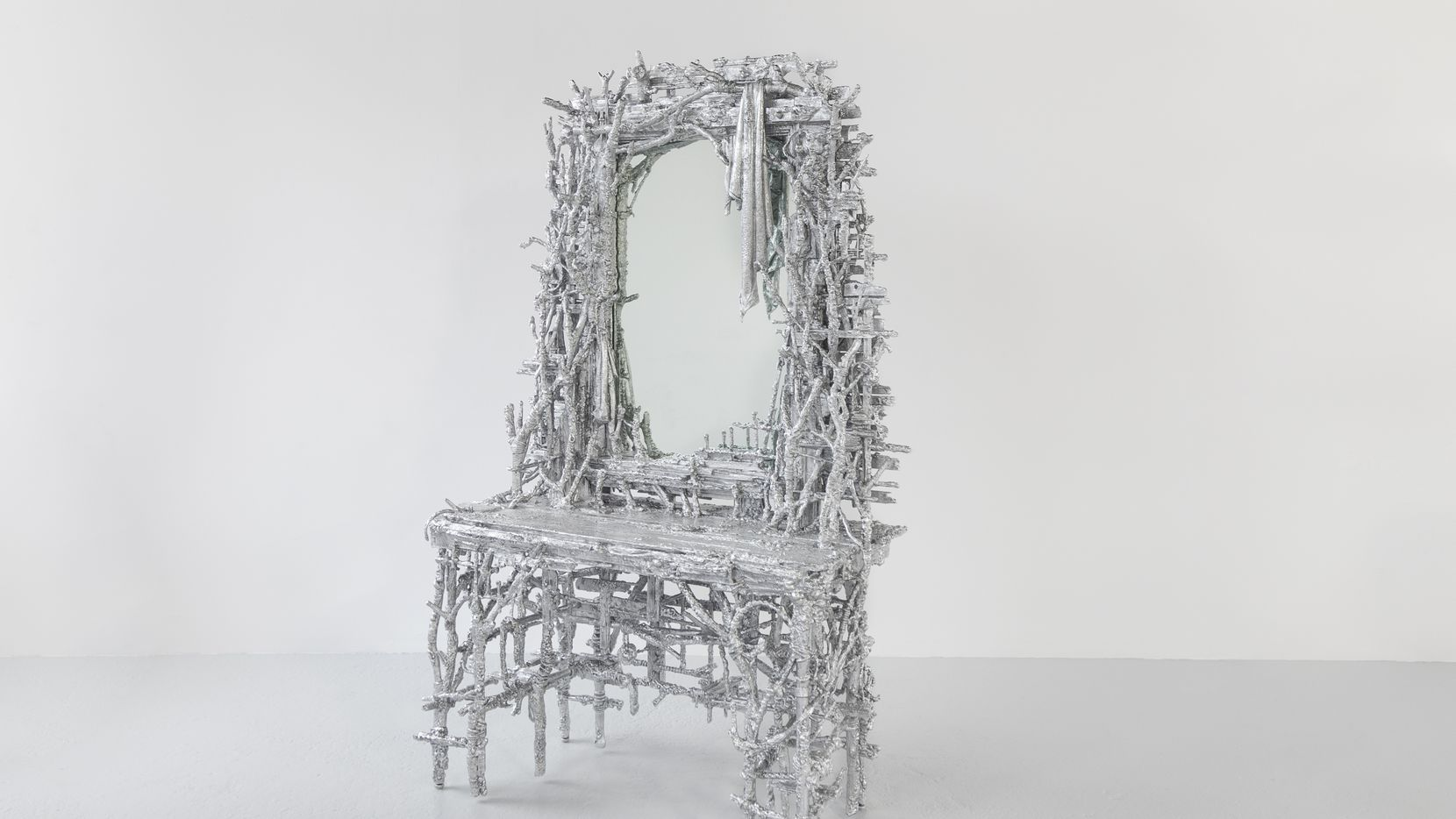 """Artist and Dallas native Chris Schanck, who now lives in Detroit, created this dressing table out of found objects that have been meticulously hand-wrapped in aluminum foil and sealed with resin. It's on display through Aug. 29 as part of the Dallas Museum of Art's """"Curbed Vanity: A Contemporary Foil by Chris Schanck."""""""