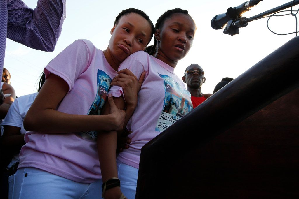 Shavon Randle's sisters Kayla Randle, 14, (right) and Shiniece Richards, 16, speak during a vigil for their sister who was killed and left in an abandoned home in Dallas.