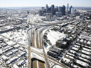 Snow covers downtown Dallas after a record snowfall on Thursday, March 5, 2015. Overnight snow and sleet blanketed the region overnight piling up to 2 to 5 inches across much of the area.