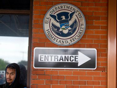 In this April 3, 2019, photo, Aurelio Catalan waits outside of the U.S. Immigration and Customs Enforcement office in Dallas with other family and friends of detainees.  Immigration agents arrested nearly 300 people on Wednesday at CVE Technology Group in Allen, a city about 15 miles northeast of Dallas, in what authorities say is one of the largest enforcement actions of its kind in a decade (Shaban Athuman/The Dallas Morning News)