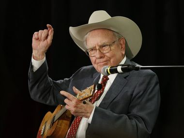 Warren Buffett, the CEO of Berkshire Hathaway, plays the ukelele at a charity event at Nebraska Furniture Mart in The Colony in 2015.