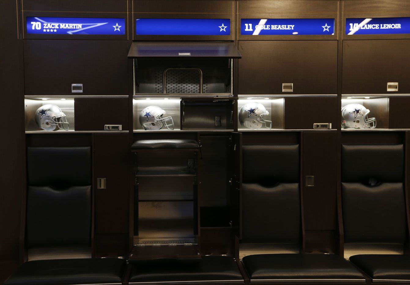 Lockers in the Dallas Cowboys locker room at the Dallas Cowboys headquarters at The Star in Frisco on July 17, 2018. The upper portion contains a cooling area for holding the shoulder pads and drying them out.