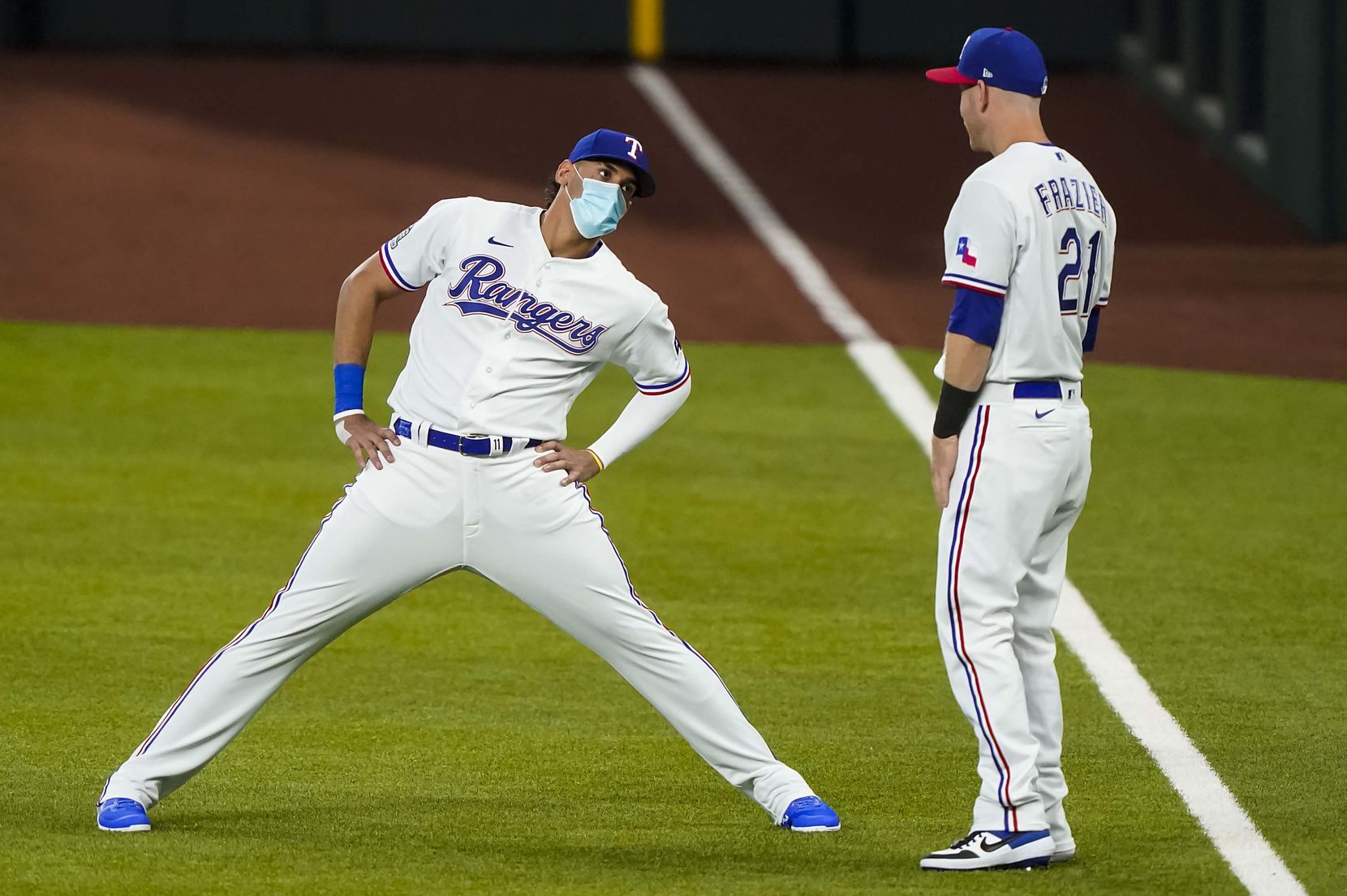 First baseman Ronald Guzman stretches with third baseman Todd Frazier during Texas Rangers Summer Camp at Globe Life Field on Thursday, July 16, 2020.