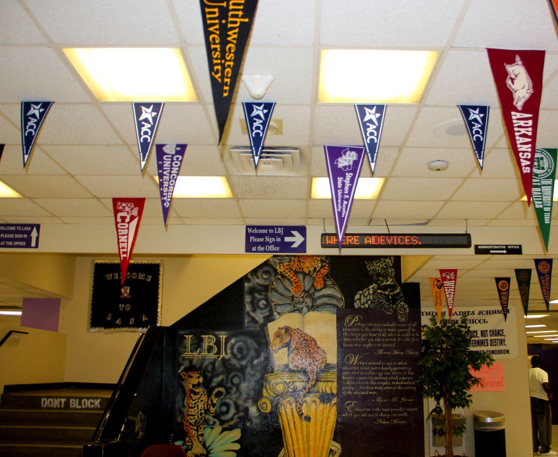 College pennants hang in the hallway at LBJ High School in Austin, Texas.